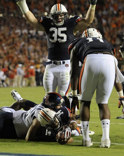 Oct 5, 2013; Auburn, AL, USA; Auburn Tigers quarterback Nick Marshall (14) scores a touchdown in the third quarter against the Mississippi Rebels at Jordan Hare Stadium. Mandatory Credit: Shanna Lockwood-USA TODAY Sports