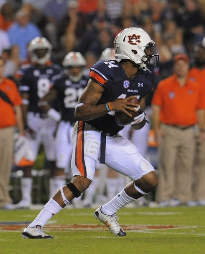 Oct 5, 2013; Auburn, AL, USA; Auburn Tigers quarterback Nick Marshall (14) looks to pass during the third quarter against the Mississippi Rebels at Jordan Hare Stadium. Mandatory Credit: Shanna Lockwood-USA TODAY Sports