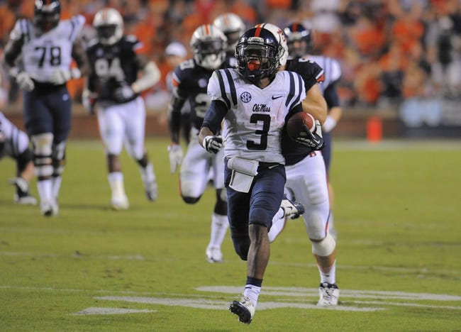 Oct 5, 2013; Auburn, AL, USA; Mississippi Rebels running back Jeff Scott (3) runs the ball during the third quarter against the Auburn Tigers at Jordan Hare Stadium. Mandatory Credit: Shanna Lockwood-USA TODAY Sports