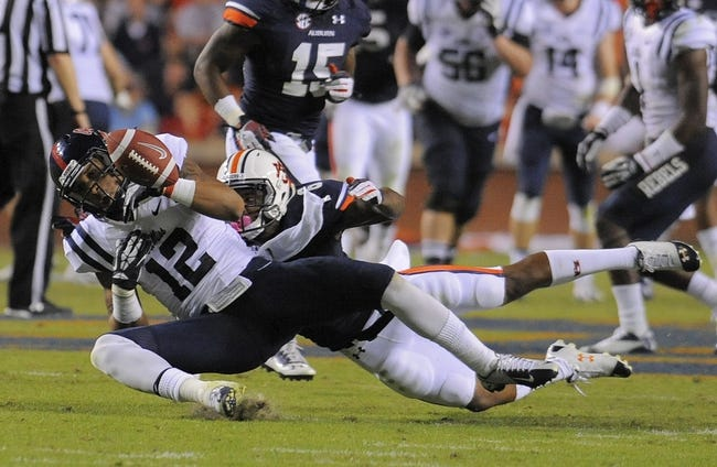 Oct 5, 2013; Auburn, AL, USA; Mississippi Rebels wide receiver Donte Moncrief (12) fails to catch a pass during the third quarter against the Auburn Tigers at Jordan Hare Stadium. Mandatory Credit: Shanna Lockwood-USA TODAY Sports