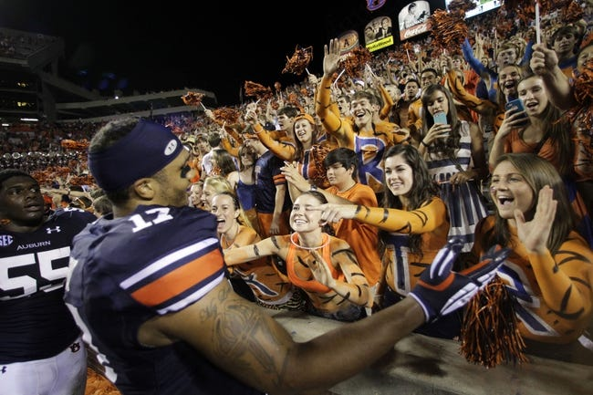 Oct 5, 2013; Auburn, AL, USA; Auburn Tigers linebacker Kris Frost (17) celebrates with fans after the Tigers beat the Mississippi Rebels 30-22 at Jordan Hare Stadium. Mandatory Credit: John Reed-USA TODAY Sports