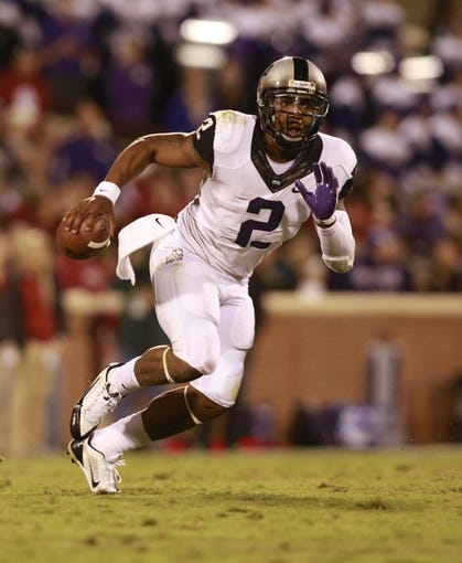 Oct 5, 2013; Norman, OK, USA; TCU Horned Frogs quarterback Trevone Boykin (2) scrambles out of the pocket against Oklahoma Sooners at Gaylord Family - Oklahoma Memorial Stadium. The Oklahoma Sooners beat the TCU Horned Frogs 20-17. Mandatory Credit: Tim Heitman-USA TODAY Sports
