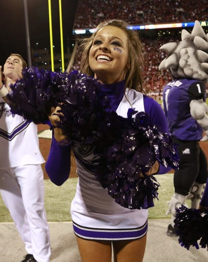 Oct 5, 2013; Norman, OK, USA; TCU Horned Frogs cheerleader on the sidelines during the game against the Oklahoma Sooners at Gaylord Family - Oklahoma Memorial Stadium. The Oklahoma Sooners beat the TCU Horned Frogs 20-17. Mandatory Credit: Tim Heitman-USA TODAY Sports
