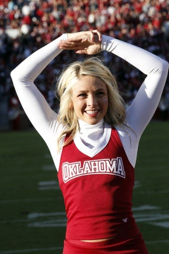 Oct 5, 2013; Norman, OK, USA; Oklahoma Sooners cheerleader on the field before the game TCU Horned Frogs at Gaylord Family - Oklahoma Memorial Stadium. Mandatory Credit: The Oklahoma Sooners beat the TCU Horned Frogs 20-17. Tim Heitman-USA TODAY Sports