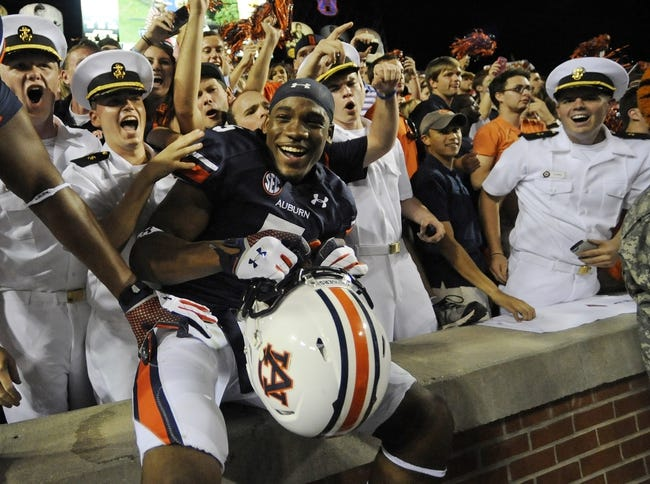 Oct 5, 2013; Auburn, AL, USA; Auburn Tigers wide receiver Ricardo Louis (5) celebrates with fans after the game against the Mississippi Rebels at Jordan Hare Stadium. The Tigers defeated the Rebels 33-20. Mandatory Credit: Shanna Lockwood-USA TODAY Sports