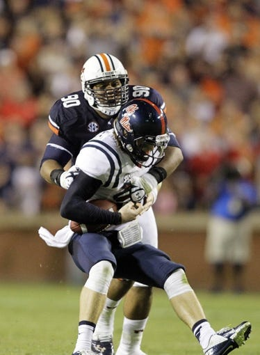 Oct 5, 2013; Auburn, AL, USA;  Mississippi Rebels quarterback Bo Wallace (14) is tackled by Auburn Tigers lineman Gabe Wright (90) during the second half at Jordan Hare Stadium.  The Tigers beat the Rebels 30-22. Mandatory Credit: John Reed-USA TODAY Sports
