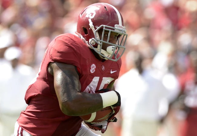 Oct 5, 2013; Tuscaloosa, AL, USA; Alabama Crimson Tide running back Jalston Fowler (45) rushes up the field against the Georgia State Panthers during the second quarter at Bryant-Denny Stadium. Mandatory Credit: John David Mercer-USA TODAY Sports