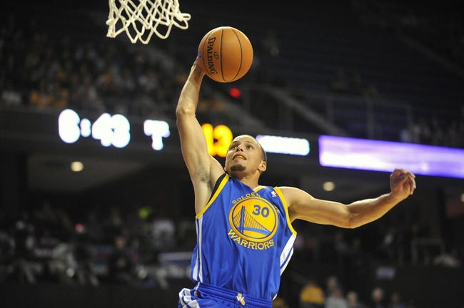 October 5, 2013; Ontario, CA, USA; Golden State Warriors Stephen Curry (30) dunks to score a basket against the Los Angeles Lakers during the first half at Citizens Business Bank Arena. Mandatory Credit: Gary A. Vasquez-USA TODAY Sports