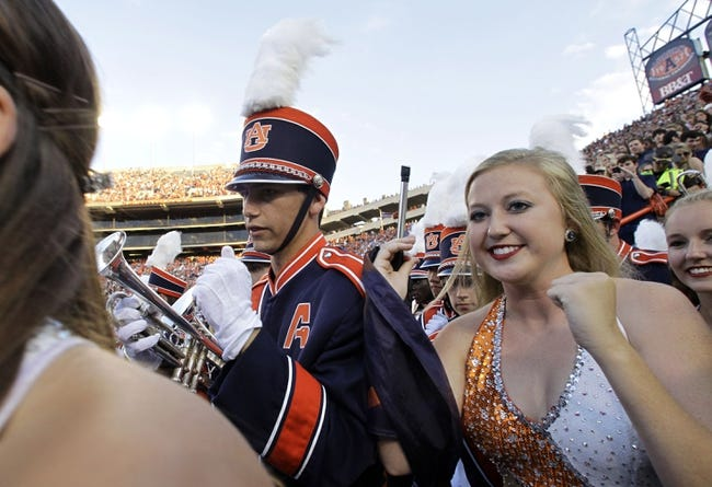 Oct 5, 2013; Auburn, AL, USA;  Members of the Auburn University Marching Band enter the field at Jordan Hare Stadium before the game between the Auburn Tigers and the Mississippi Rebels.  The Tigers beat the Rebels 30-22. Mandatory Credit: John Reed-USA TODAY Sports