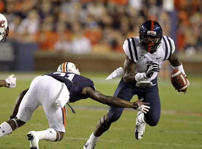 Oct 5, 2013; Auburn, AL, USA;  Mississippi Rebels receiver Laquon Treadwell (1) avoids Auburn Tigers defensive backs Jermaine Whitehead (9) and Mackenro Alexander (21) during the first half at Jordan Hare Stadium.  The Tigers beat the Rebels 30-22. Mandatory Credit: John Reed-USA TODAY Sports