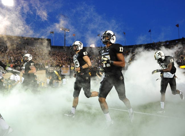 Oct 5, 2013; Nashville, TN, USA; Vanderbilt Commodores wide receiver Jonathan Krause (17) runs onto the field before a game against the Missouri Tigers at Vanderbilt Stadium. The Tigers beat the Commodores 51-28. Mandatory Credit: Don McPeak-USA TODAY Sports