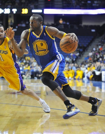 October 5, 2013; Ontario, CA, USA; Golden State Warriors shooting guard Andre Iguodala (9) moves the ball against the Los Angeles Lakers during the first half at Citizens Business Bank Arena. Mandatory Credit: Gary A. Vasquez-USA TODAY Sports