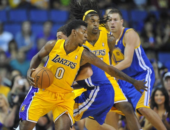 October 5, 2013; Ontario, CA, USA; Los Angeles Lakers shooting guard Nick Young (0) moves the ball against the Golden State Warriors during the first half at Citizens Business Bank Arena. Mandatory Credit: Gary A. Vasquez-USA TODAY Sports