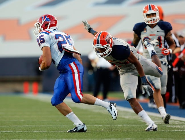 Oct 5, 2013; El Paso, TX, USA; Louisiana Tech Bulldogs running back Blake Martin (25) breaks a tackle and runs in for a touchdown against the UTEP Miners at Sun Bowl Stadium. Mandatory Credit: Ivan Pierre Aguirre-USA TODAY Sports