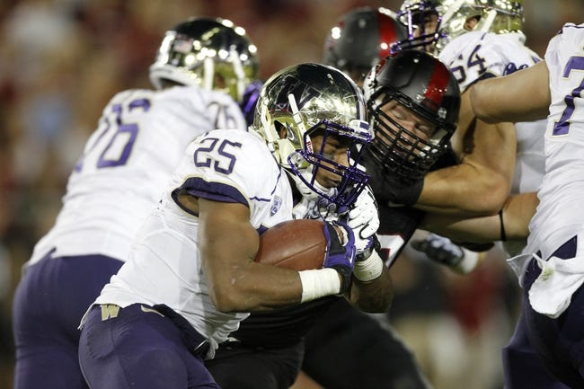 Oct 5, 2013; Stanford, CA, USA; Washington Huskies running back Bishop Sankey (25) runs the ball against the Stanford Cardinal in the second quarter at Stanford Stadium. Mandatory Credit: Cary Edmondson-USA TODAY Sports