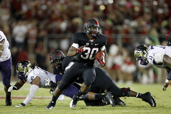 Oct 5, 2013; Stanford, CA, USA; Stanford Cardinal running back Ricky Seale (30) runs the ball against the Washington Huskies in the first quarter at Stanford Stadium. Mandatory Credit: Cary Edmondson-USA TODAY Sports
