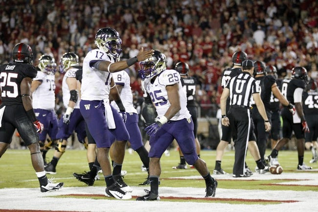 Oct 5, 2013; Stanford, CA, USA; Washington Huskies running back Bishop Sankey (25) is congratulated by quarterback Keith Price (17) after scoring a touchdown against the Stanford Cardinal in the second quarter at Stanford Stadium. Mandatory Credit: Cary Edmondson-USA TODAY Sports