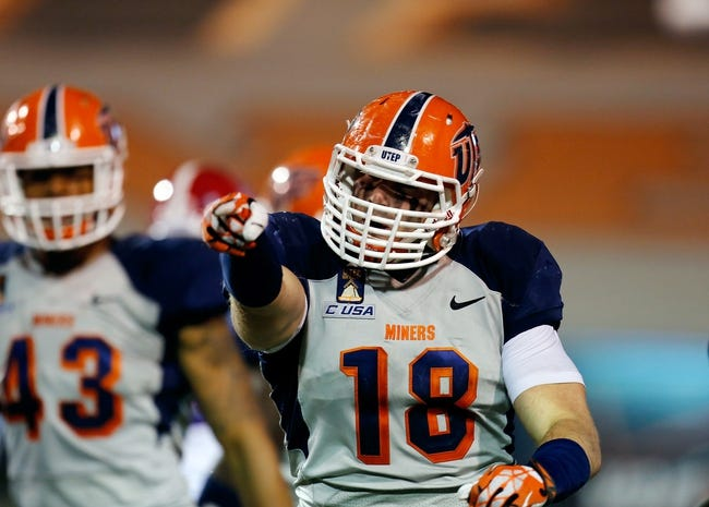 Oct 5, 2013; El Paso, TX, USA; UTEP defensive lineman James Davidson (18) points to the sideline after making a big tackle for a loss against the Louisiana Tech Bulldogs at Sun Bowl Stadium. Mandatory Credit: Ivan Pierre Aguirre-USA TODAY Sports