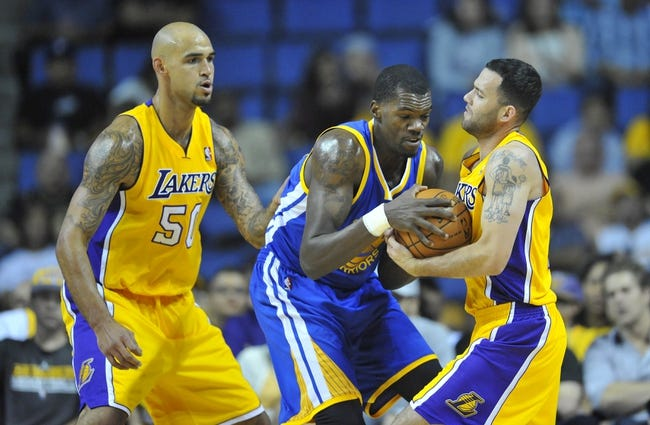 October 5, 2013; Ontario, CA, USA; Golden State Warriors center Dewayne Dedmon (21) has the ball stolen against the defense of Los Angeles Lakers point guard Jordan Farmar (1) during the second half at Citizens Business Bank Arena. Mandatory Credit: Gary A. Vasquez-USA TODAY Sports