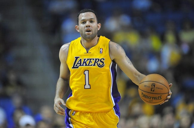 October 5, 2013; Ontario, CA, USA; Los Angeles Lakers point guard Jordan Farmar (1) moves the ball up court against the Golden State Warriors during the second half at Citizens Business Bank Arena. Mandatory Credit: Gary A. Vasquez-USA TODAY Sports