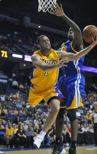 October 5, 2013; Ontario, CA, USA; Los Angeles Lakers point guard Jordan Farmar (1) goes in for a basket against the Golden State Warriors during the second half at Citizens Business Bank Arena. Mandatory Credit: Gary A. Vasquez-USA TODAY Sports