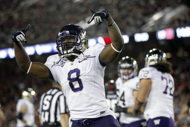 Oct 5, 2013; Stanford, CA, USA; Washington Huskies wide receiver Kevin Smith (8) reacts after catching a touchdown pass against the Stanford Cardinal in the third quarter at Stanford Stadium. Mandatory Credit: Cary Edmondson-USA TODAY Sports