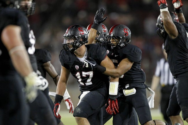 Oct 5, 2013; Stanford, CA, USA; Stanford Cardinal inside linebacker A.J. Tarpley (17) is congratulated by teammates after intercepting a pass against the Washington Huskies in the fourth quarter at Stanford Stadium. The Cardinal defeated the Huskies 31-28. Mandatory Credit: Cary Edmondson-USA TODAY Sports