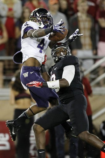 Oct 5, 2013; Stanford, CA, USA; Washington Huskies wide receiver Jaydon Mickens (4) is unable to make a catch over the top of Stanford Cardinal strong safety Jordan Richards (8) in the fourth quarter at Stanford Stadium. The Cardinal defeated the Huskies 31-28. Mandatory Credit: Cary Edmondson-USA TODAY Sports