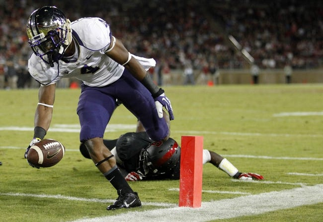 Oct 5, 2013; Stanford, CA, USA; Washington Huskies wide receiver Jaydon Mickens (4) scores a touchdown against the Stanford Cardinal in the fourth quarter at Stanford Stadium. The Cardinal defeated the Huskies 31-28. Mandatory Credit: Cary Edmondson-USA TODAY Sports