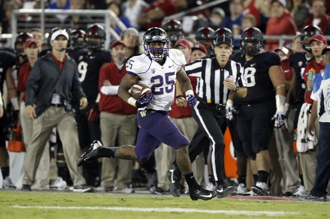 Oct 5, 2013; Stanford, CA, USA; Washington Huskies running back Bishop Sankey (25) runs the ball against the Stanford Cardinal in the third quarter at Stanford Stadium. The Cardinal defeated the Huskies 31-28. Mandatory Credit: Cary Edmondson-USA TODAY Sports