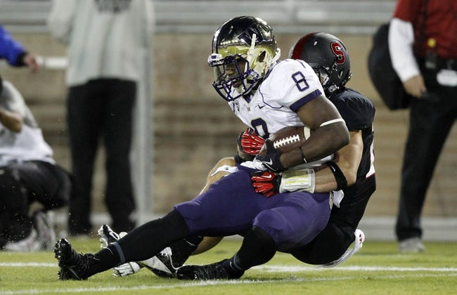 Oct 5, 2013; Stanford, CA, USA; Washington Huskies wide receiver Kevin Smith (8) catches a touchdown pass against the Stanford Cardinal in the third quarter at Stanford Stadium.The Cardinal defeated the Huskies 31-28. Mandatory Credit: Cary Edmondson-USA TODAY Sports
