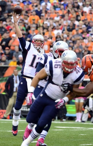 Oct 6, 2013; Cincinnati, OH, USA; New England Patriots quarterback Tom Brady (12) throws a pass against the Cincinnati Bengals at Paul Brown Stadium. The Bengals won 13-6.  Mandatory Credit: Marc Lebryk-USA TODAY Sports