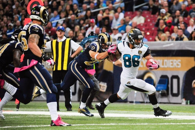 Oct 6, 2013; St. Louis, MO, USA; Jacksonville Jaguars tight end Clay Harbor (86) carries the ball as St. Louis Rams free safety Matt Giordano (27) defends during the second half at the Edward Jones Dome. St. Louis defeated Jacksonville 34-20. Mandatory Credit: Jeff Curry-USA TODAY Sports