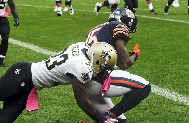 Oct 6, 2013; Chicago, IL, USA; Chicago Bears wide receiver Brandon Marshall (15) scores a touchdown against New Orleans Saints cornerback Jabari Greer (33) during the second half at Soldier Field.  Mandatory Credit: Matt Marton-USA TODAY Sports