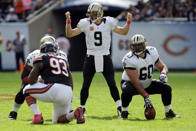 Oct 6, 2013; Chicago, IL, USA; New Orleans Saints quarterback Drew Brees (9) during the second half against the Chicago Bears at Soldier Field. Mandatory Credit: Matt Marton-USA TODAY Sports