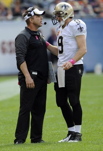 Oct 6, 2013; Chicago, IL, USA; New Orleans Saints quarterback Drew Brees (9) talks with head coach Sean Payton during the second half against the Chicago Bears at Soldier Field. Mandatory Credit: Matt Marton-USA TODAY Sports