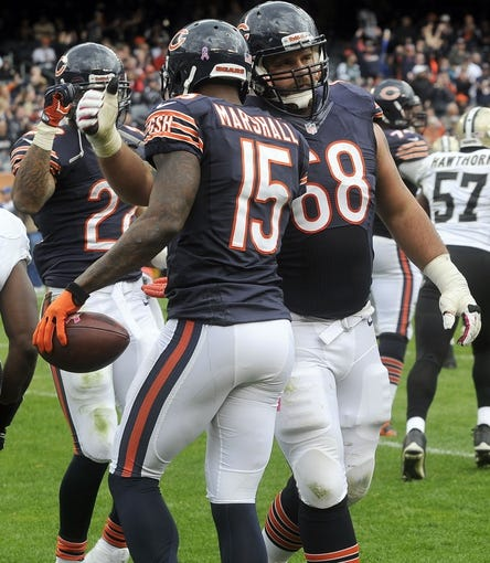 Oct 6, 2013; Chicago, IL, USA; Chicago Bears wide receiver Brandon Marshall (15) celebrates his touchdown with guard Matt Slauson (68) during the second half against New Orleans at Soldier Field. Mandatory Credit: Matt Marton-USA TODAY Sports