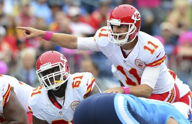 Oct 6, 2013; Nashville, TN, USA; Kansas City Chiefs quarterback Alex Smith (11) makes adjustments at the line against the Tennessee Titans during the first half at LP Field. The Chiefs beat the Titans 26-17. Mandatory Credit: Don McPeak-USA TODAY Sports