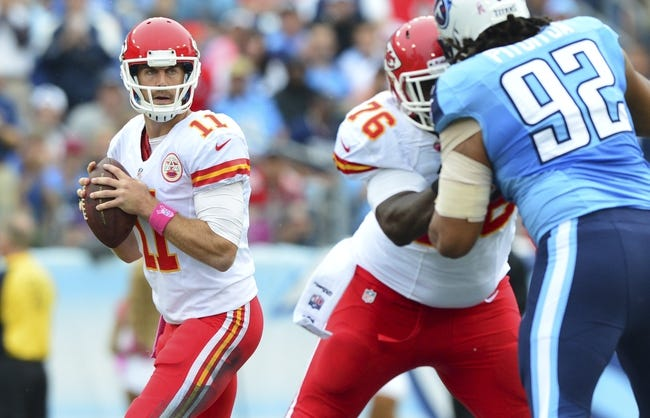 Oct 6, 2013; Nashville, TN, USA; Kansas City Chiefs quarterback Alex Smith (11) looks for an open receiver against the Tennessee Titans during the first half at LP Field. The Chiefs beat the Titans 26-17. Mandatory Credit: Don McPeak-USA TODAY Sports
