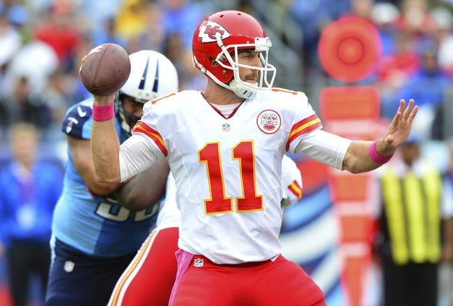 Oct 6, 2013; Nashville, TN, USA; Kansas City Chiefs quarterback Alex Smith (11) drops back into the pocket to pass against the Tennessee Titans during the first half at LP Field. The Chiefs beat the Titans 26-17. Mandatory Credit: Don McPeak-USA TODAY Sports