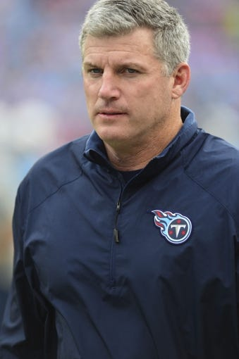 Oct 6, 2013; Nashville, TN, USA; Tennessee Titans head coach Mike Munchak watches his team warm up against the Kansas City Chiefs during the second half at LP Field. The Chiefs beat the Titans 26-17. Mandatory Credit: Don McPeak-USA TODAY Sports