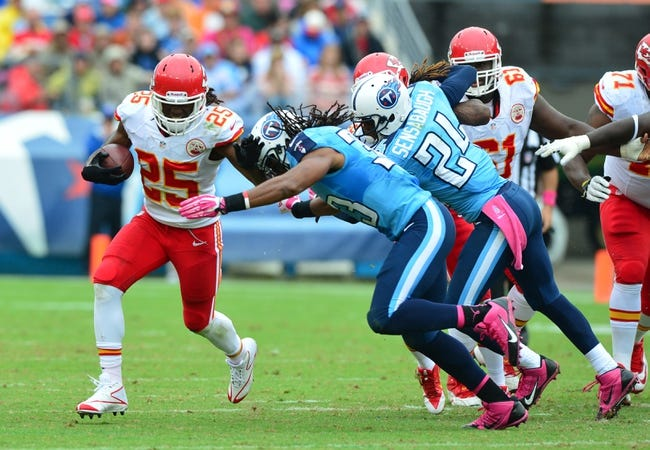 Oct 6, 2013; Nashville, TN, USA; Kansas City Chiefs running back Jamaal Charles (25) carries the ball against Tennessee Titans safety Michael Griffin (33) during the first half at LP Field. The Chiefs beat the Titans 26-17. Mandatory Credit: Don McPeak-USA TODAY Sports