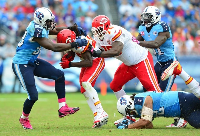 Oct 6, 2013; Nashville, TN, USA; Tennessee Titans linebacker Moise Fokou (53) tackles Kansas City Chiefs running back Jamaal Charles (25) during the second half at LP Field. The Chiefs beat the Titans 26-17. Mandatory Credit: Don McPeak-USA TODAY Sports