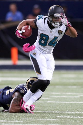 Oct 6, 2013; St. Louis, MO, USA; Jacksonville Jaguars wide receiver Cecil Shorts (84) carries the ball as St. Louis Rams cornerback Trumaine Johnson (22) attempts to tackle during the first quarter at The Edward Jones Dome. Mandatory Credit: Scott Kane-USA TODAY Sports