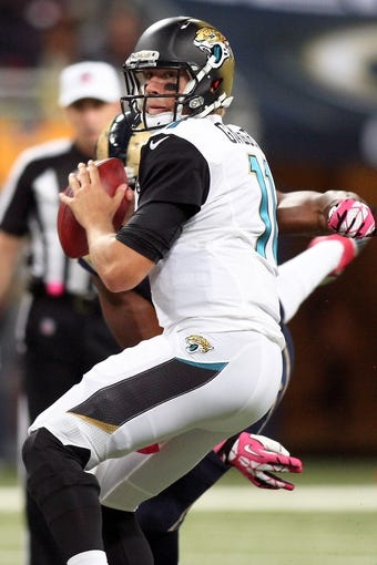 Oct 6, 2013; St. Louis, MO, USA; Jacksonville Jaguars quarterback Blaine Gabbert (11) looks to pass the ball during the first half against the St. Louis Rams at The Edward Jones Dome. Mandatory Credit: Scott Kane-USA TODAY Sports