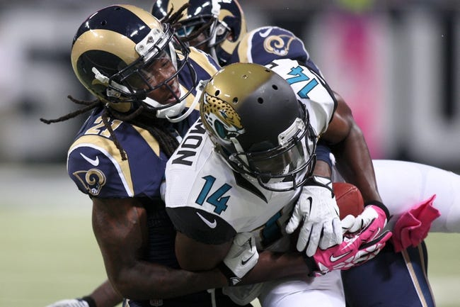 Oct 6, 2013; St. Louis, MO, USA; Jacksonville Jaguars wide receiver Justin Blackmon (14) is tackled by St. Louis Rams cornerback Janoris Jenkins (21) during the first half at The Edward Jones Dome. Mandatory Credit: Scott Kane-USA TODAY Sports