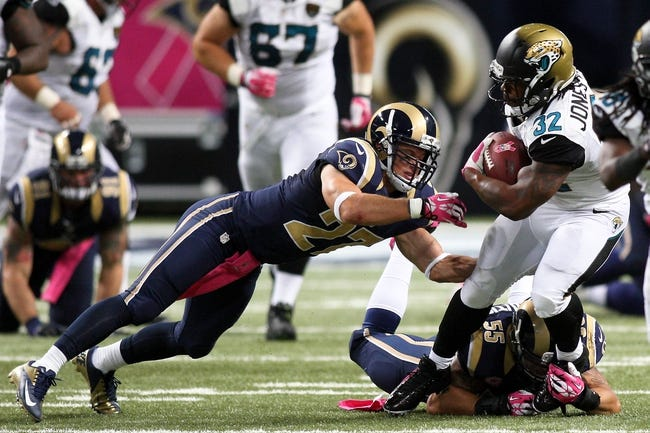 Oct 6, 2013; St. Louis, MO, USA; St. Louis Rams free safety Matt Giordano (27) dives for Jacksonville Jaguars running back Maurice Jones-Drew (32) as he carries the ball during the fourth quarter at The Edward Jones Dome. Mandatory Credit: Scott Kane-USA TODAY Sports