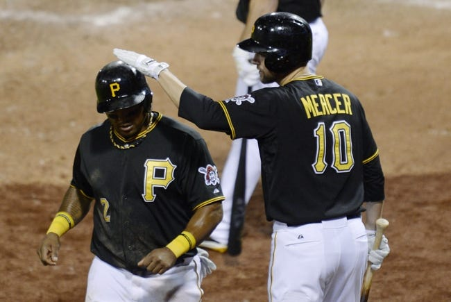 Oct 6, 2013; Pittsburgh, PA, USA; Pittsburgh Pirates right fielder Marlon Byrd (2) is congratulated by teammate Jordy Mercer (10) after scoring a run against the St. Louis Cardinals during the 8th inning in game three of the National League divisional series playoff baseball game at PNC Park. Mandatory Credit: H.Darr Beiser-USA TODAY Sports