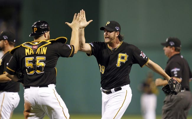 Oct 6, 2013; Pittsburgh, PA, USA; Pittsburgh Pirates relief pitcher Jason Grilli (39) celebrates with catcher Russell Martin (55) after game three of the National League divisional series playoff baseball game against the St. Louis Cardinals at PNC Park. Mandatory Credit: Charles LeClaire-USA TODAY Sports