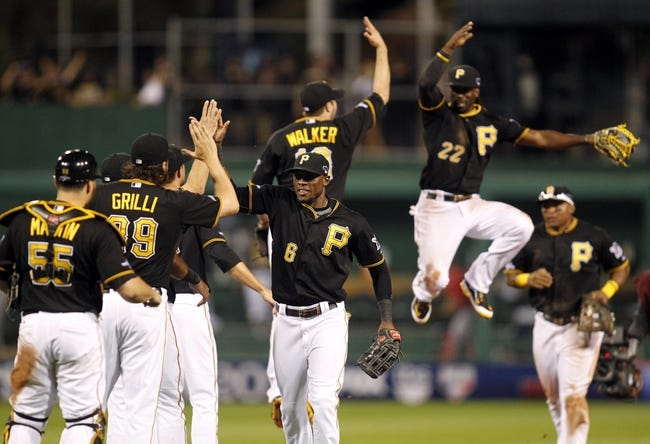 Oct 6, 2013; Pittsburgh, PA, USA; Pittsburgh Pirates players including Starling Marte (6) , Russell Martin (55) , Jason Grilli (39) and Andrew McCutchen (22) celebrate after game three of the National League divisional series playoff baseball game against the St. Louis Cardinals at PNC Park. Mandatory Credit: Charles LeClaire-USA TODAY Sports